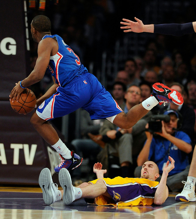 . The Clippers Chris Paul #3 drives over the Lakers\' Steve Blake #5 during their game at the Staples Center Friday, November 2, 2012. The Clippers beat the Lakers 105-95.  (Hans Gutknecht/Los Angeles Daily News)