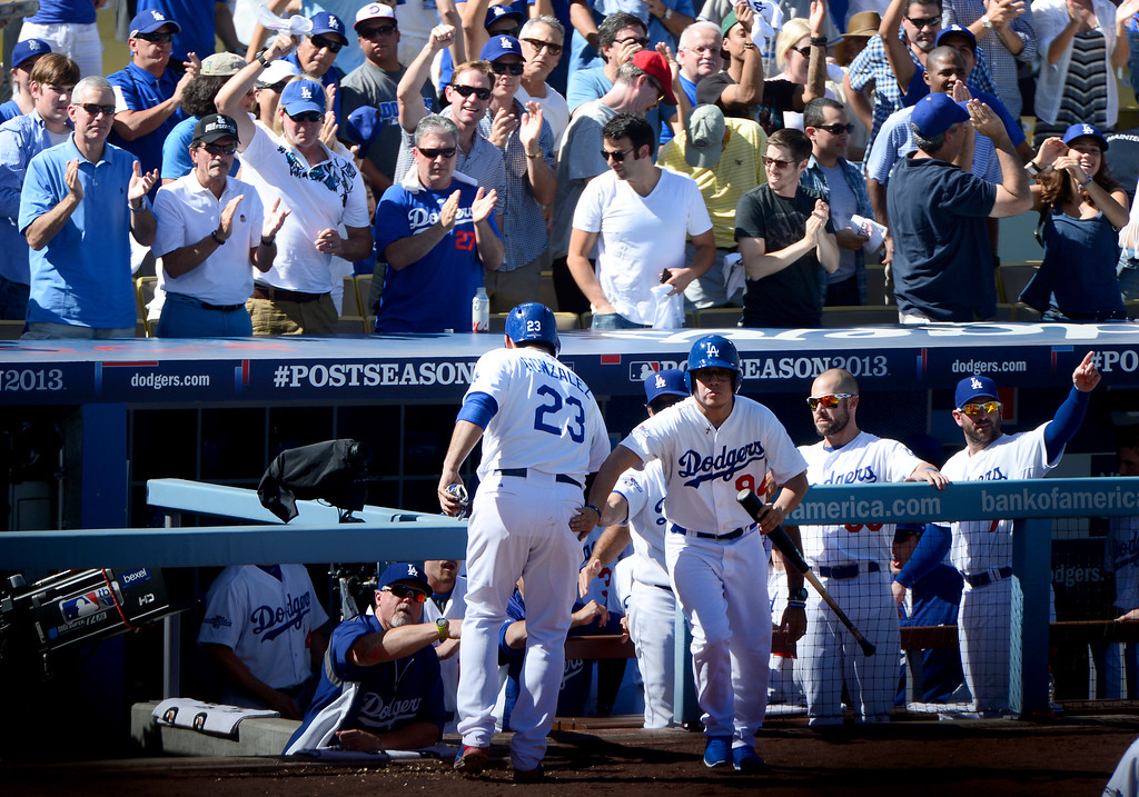 . Los Angeles Dodgers\' Adrian Gonzalez scores the first run on a Juan Uribe hit during the second of game 5 of the NLCS at Dodger Stadium Wednesday, October 16, 2013. (Photo by Sarah Reingewirtz/Los Angeles Daily News)