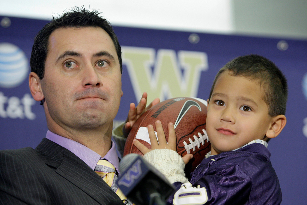 . New Washington football coach Steve Sarkisian holds his son, Brady, 3, at a news conference announcing his hiring at the school Monday, Dec. 8, 2008, in Seattle.  (AP Photo/Elaine Thompson)
