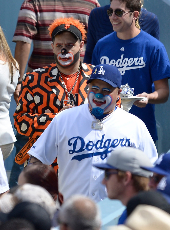 . A couple guys dressed like a Giants clown and a Dodgers clown return to their seats after getting a beer. The Dodgers played the San Francisco Giants on Opening Day at Dodger Stadium. Los Angeles, CA. April 3, 2014 (Photo by John McCoy / Los Angeles Daily News)