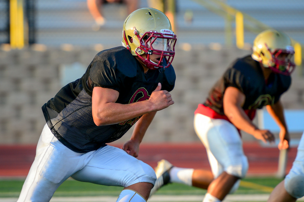 . Oaks Christian DE Trevor Howard runs a drill at practice, Wednesday, August 20, 2014. (Photo by Michael Owen Baker/Los Angeles Daily News)