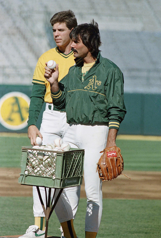 . Oakland A\'s relief pitcher Dennis Eckersley, right, charged with the loss in game one of the World Series, and fellow pitcher Storm Davis, the losing pitcher in game two, get together on the field prior to the start of game four of the World Series against the Los Angeles Dodgers at Oakland Coliseum, Wednesday, Oct. 19, 1988, Oakland, Calif. (AP Photo/Eric Risberg)
