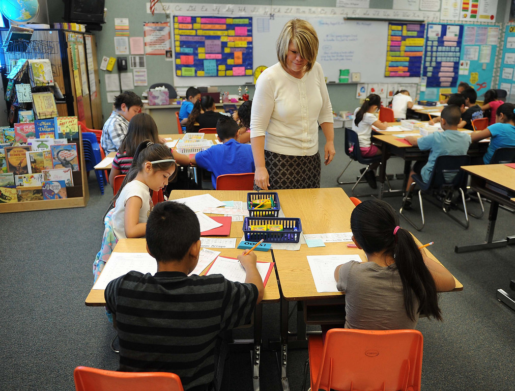 . Students wait to hear about their Star test scores on Thursday in Shannon McCreight\'s third-grade class at Myers Elementary School in Rialto (LaFonzo Carter/Staff Photographer)