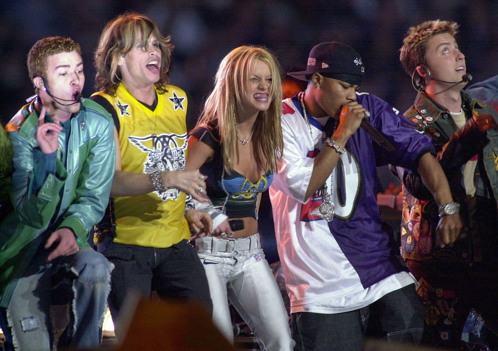. Singer Britney Spears, flanked by Steven Tyler of Aerosmtih, second from left, and hip-hop star Nelly, second from right, join  \'N Sync members Justin Timberlake, far left, and Lance Bass, far right on stage for the halftime show of Super Bowl XXXV on Sunday, Jan. 28, 2001, in Tampa, Fla. (AP Photo/Amy E. Conn)