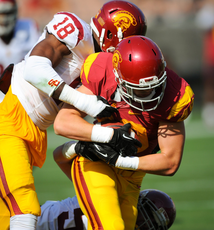 . USC LB Quinton Powell tackles TE Connor Spears at the spring game. (Photo by Michael Owen Baker/L.A. Daily News)