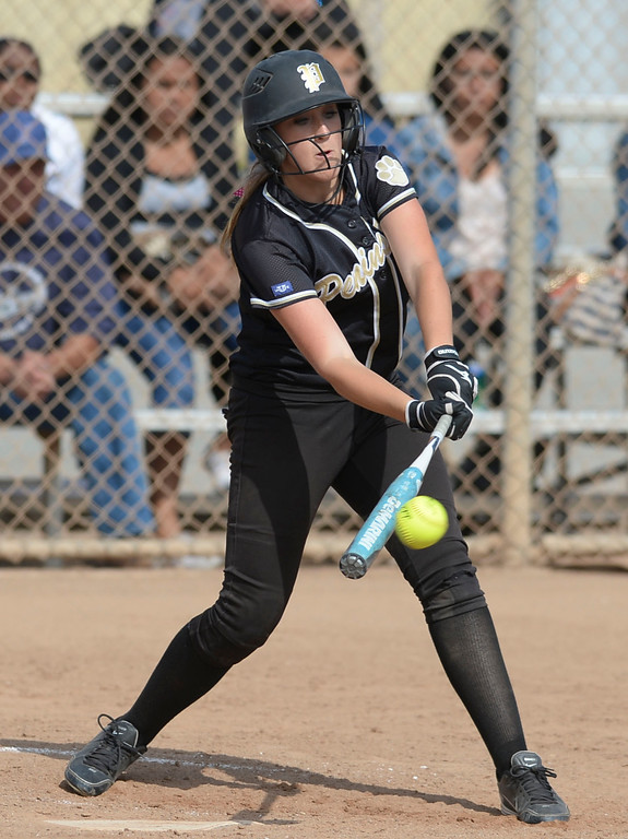 . Peninsula\'s Katie Holcomb (17) connects with a North pitch in a first round CIF SS Division III softball game Thursday in Torrance. Peninsula won 4-1. 20130516 Photo by Steve McCrank / Staff Photographer
