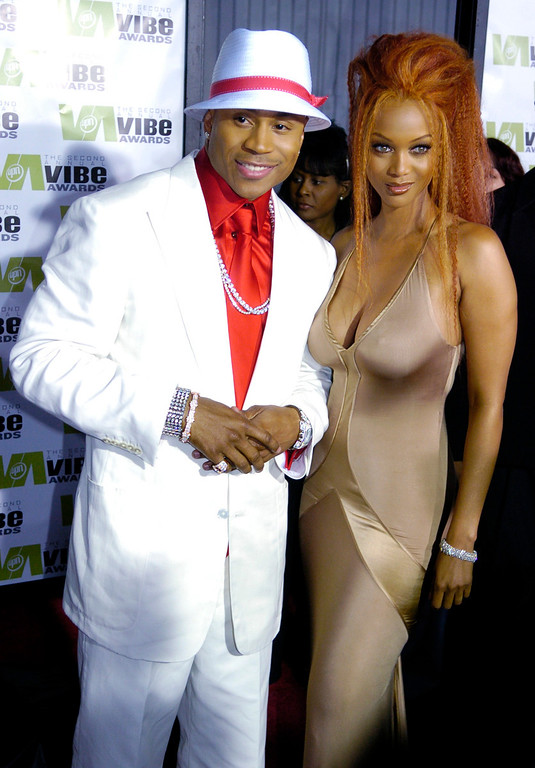 . LL Cool J and Tyra Banks, co-hosts of the Second Annual Vibe Awards, pose together on the red carpet at Barker Hangar in Santa Monica, Calif., Monday, Nov. 15, 2004.  (AP Photo/Chris Pizzello)