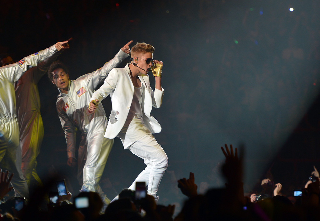 ". Canadian singer Justin Bieber performs during a concert as part of his ""I Believe\"" tour at the Palais Omnisport de Paris-Bercy (POPB), on March 19, 2013.            (MIGUEL MEDINA/AFP/Getty Images)"