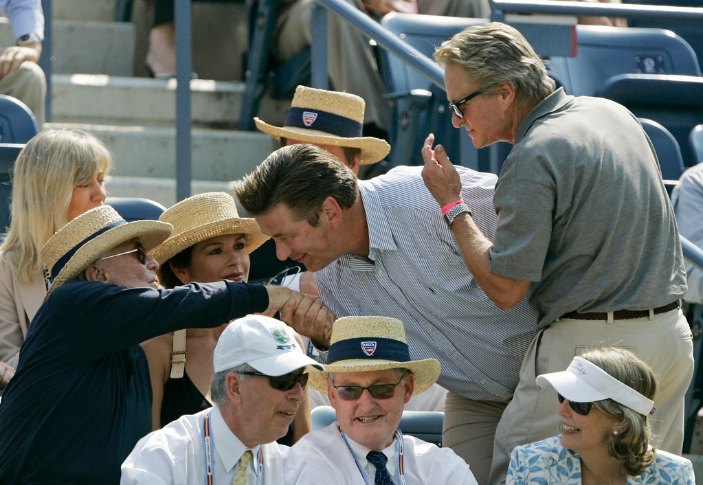 . Michael Douglas, right, watches as Alex Baldwin kisses Kirk Douglas\'s hands during the semifinal match between Novak Djokovic of Serbia and David Ferrer of Spain at the US Open tennis tournament in New York, Saturday, Sept. 8, 2007. At center is Catherine Zeta-Jones. (AP Photo/Elise Amendola)