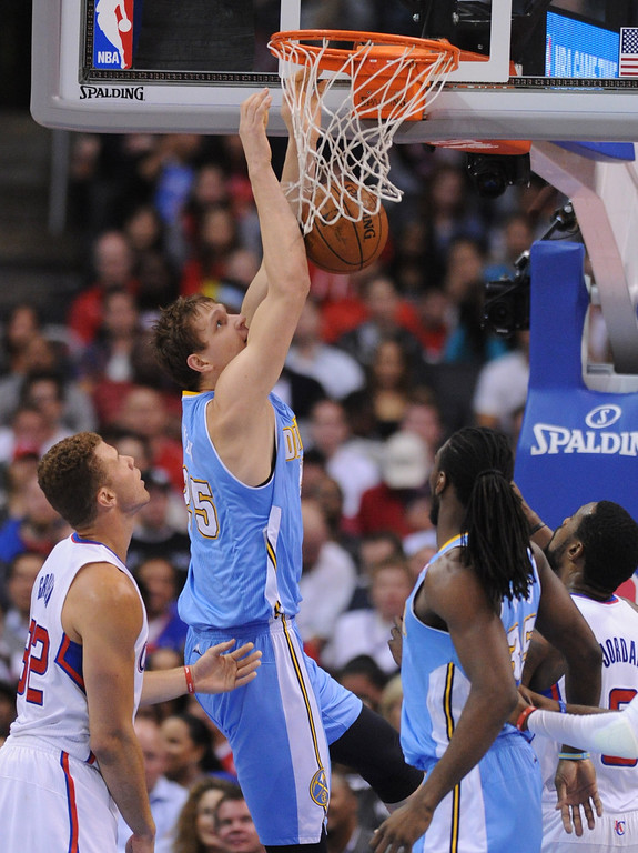 . Nuggets #25 Timofey Mozgov dunks in the first half. The Los Angeles Clippers took on the Denver Nuggets in a regular season NBA game. Los Angeles, CA. 4/15/2014(Photo by John McCoy / Los Angeles Daily News)