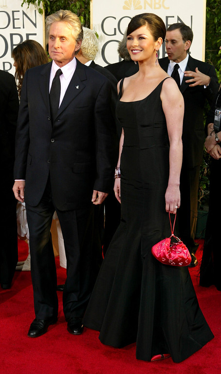. Michael Douglas and his wife, Catherine Zeta-Jones, arrive for the 61st Annual Golden Globe Awards on Sunday, Jan. 25, 2004, in Beverly Hills, Calif.  Douglas was honored with the Cecil B. DeMille Award. (AP Photo/Kevork Djansezian)