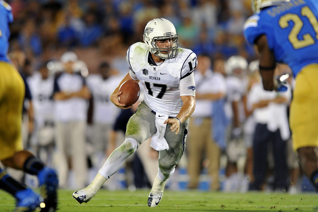 . Nevada QB Cody Fajardo runs for yardage against UCLA, Saturday, August 31, 2013, at the Rose Bowl. (Michael Owen Baker/L.A. Daily News)