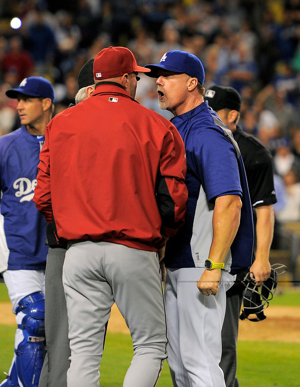 . Los Angeles Dodgers batting coach Mark McGwire, right, yells at Arizona Diamondbacks manager Kirk Gibson after Los Angeles Dodgers\' Zack Greinke was hit by a pitch during the seventh inning of their baseball game, Tuesday, June 11, 2013, in Los Angeles.  (AP Photo/Mark J. Terrill)