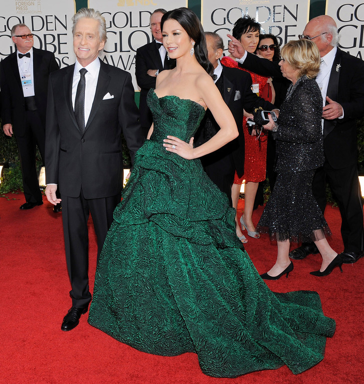 . Michael Douglas and Catherine Zeta-Jones arrive before the Golden Globe Awards Sunday, Jan. 16, 2011, in Beverly Hills, Calif. (AP Photo/Chris Pizzello)