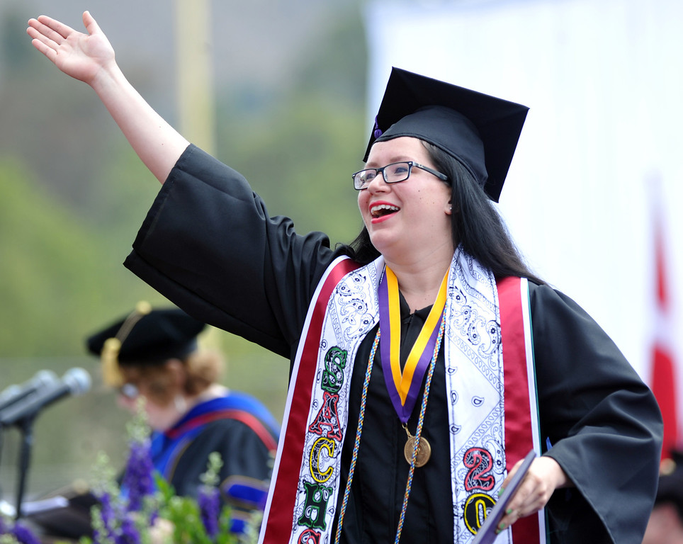 . Ginger Maneske blows kisses after receiving her diploma during the 110th Commencement Ceremony at Memorial Stadium on the Whittier College campus in Whittier on Friday May 17, 2013. Award-winning journalist Sonia Nazario gave the keynote address and received an honorary degree from the Whittier College faculty: a doctorate of humane letters.(SGVN/Staff Photo by Keith Durflinger)