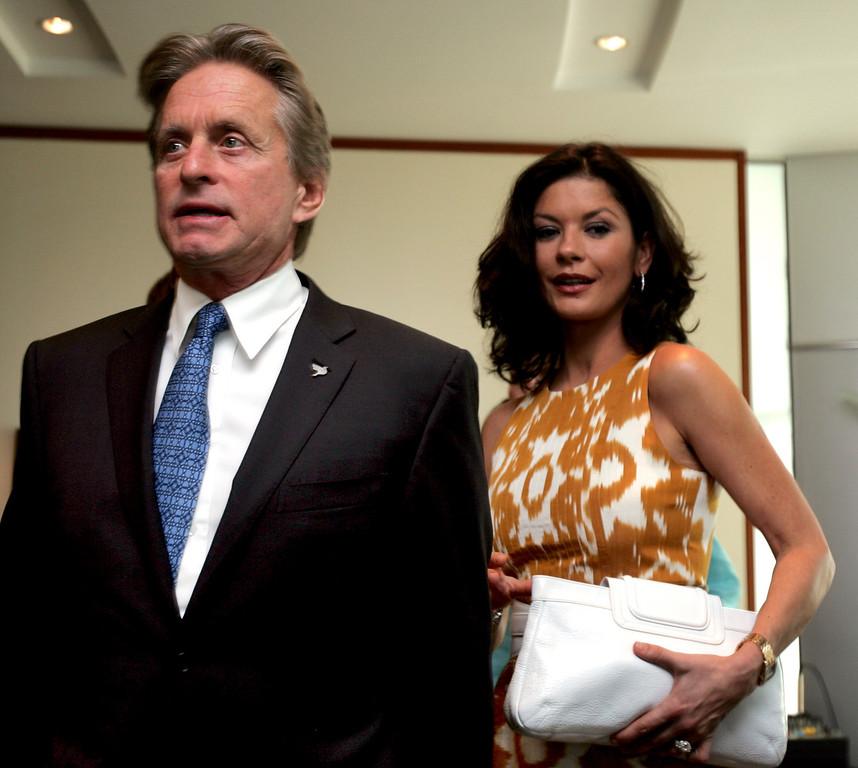 . British actress, Catherine Zeta Jones, follows her husband, U.S. actor Michael Douglas to Free The Children press conference in Dubai, United Arab Emirates, Monday, Oct. 6, 2008. (AP Photo/Kamran Jebreili)