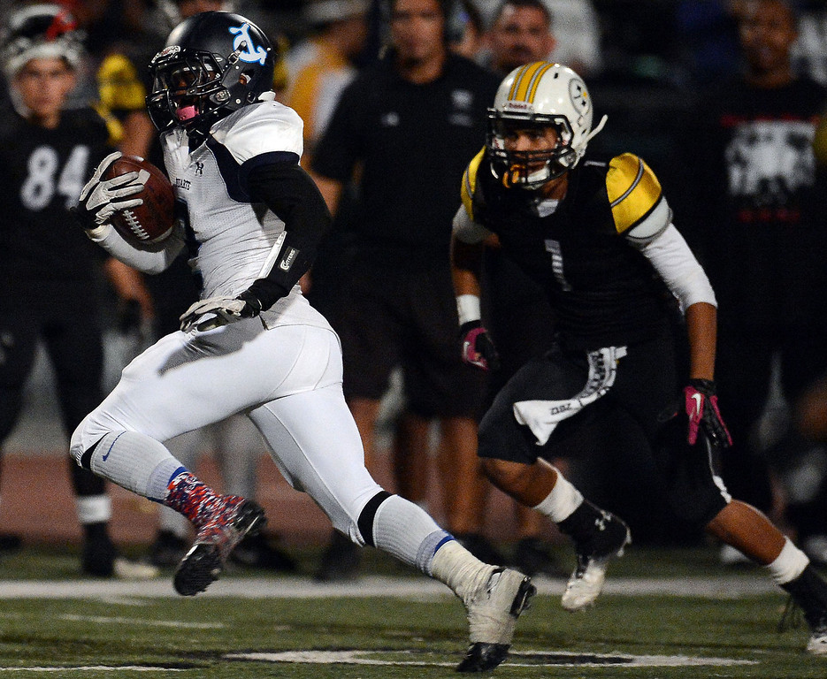 . Duarte\'s Jordan Johnson (2) catches pass and runs for a 48 yard touchdown against Bassett in the first half of a prep football game at Bassett High School in La Puente, Calif., on Friday, Nov. 1, 2013.    (Keith Birmingham Pasadena Star-News)