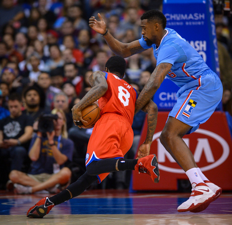 . 76ers� Tony Wroten drives against Clippers� DeAndre Jordan during first half action at Staples Center Sunday.  ( Photo by David Crane/Los Angeles Daily News )