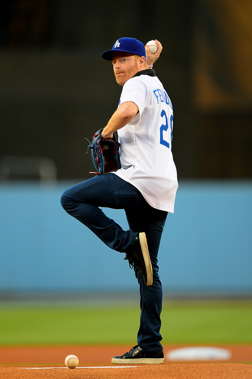 . Actor Jesse Tyler Ferguson stands on the mound to throw out the first pitch.... (Photo by Michael Owen Baker/Los Angeles Daily News)