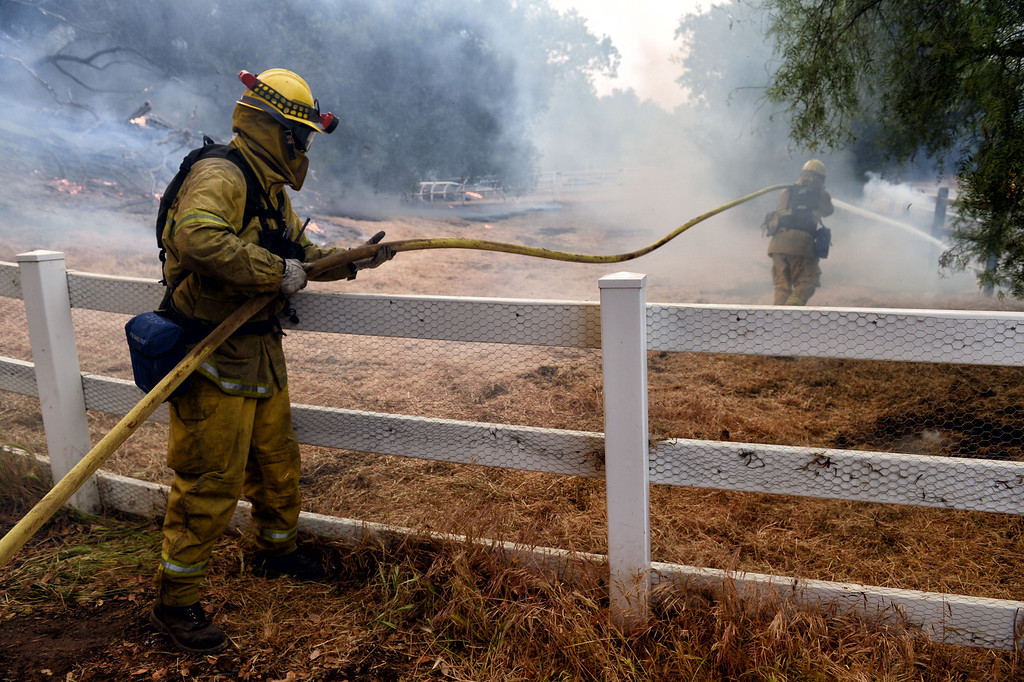 . Firefighters battle the Springs Fire near homes along Hidden Valley Rd in Thousand Oaks Friday, May 3, 2013. (Hans Gutknecht/LA Daily News)