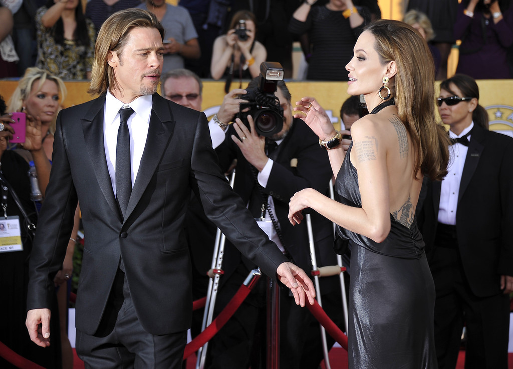 . Actors Brad Pitt and Angelina Jolie arrive to the 18th Annual Screen Actors Guild Awards at the Shrine Auditorium in Los Angeles, California on January 29, 2012. AFP PHOTO / JOE KLAMAR (Photo credit should read JOE KLAMAR/AFP/Getty Images)