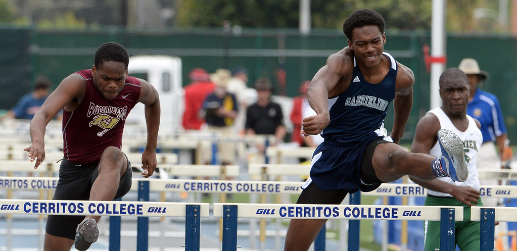 . Gabrielino\'s Gary Hawkins competes in the division 3 110 meter high hurdles during the CIF Southern Section track and final Championships at Cerritos College in Norwalk, Calif., Saturday, May 24, 2014. 