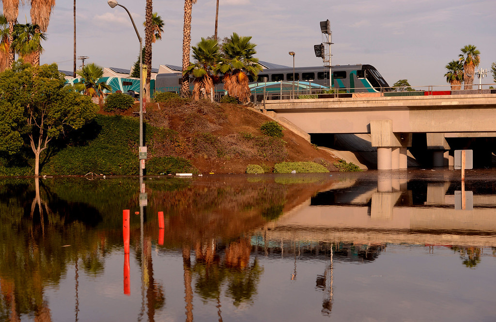 . A Metrolink train returning to the station is reflected in the intersection of Fourteenth and Vine Streets near the 91 freeway in Riverside August 29, 2013.  GABRIEL LUIS ACOSTA/STAFF PHOTOGRAPHER.