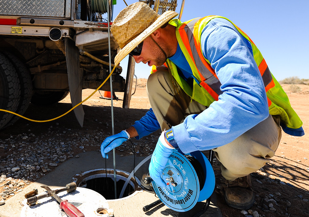 . Eric Randell, a PG&E groundwater sampling tech, collects water from PG&E\'s testing wells in Hinkley, Calif. on Thursday, May 2, 2013. PG&E and the Lahontan Regional Water Quality Water Board developed remediation actions to clean and contain the chromium-6 groundwater plume below Hinkley. (Rachel Luna / San Bernardino Sun)