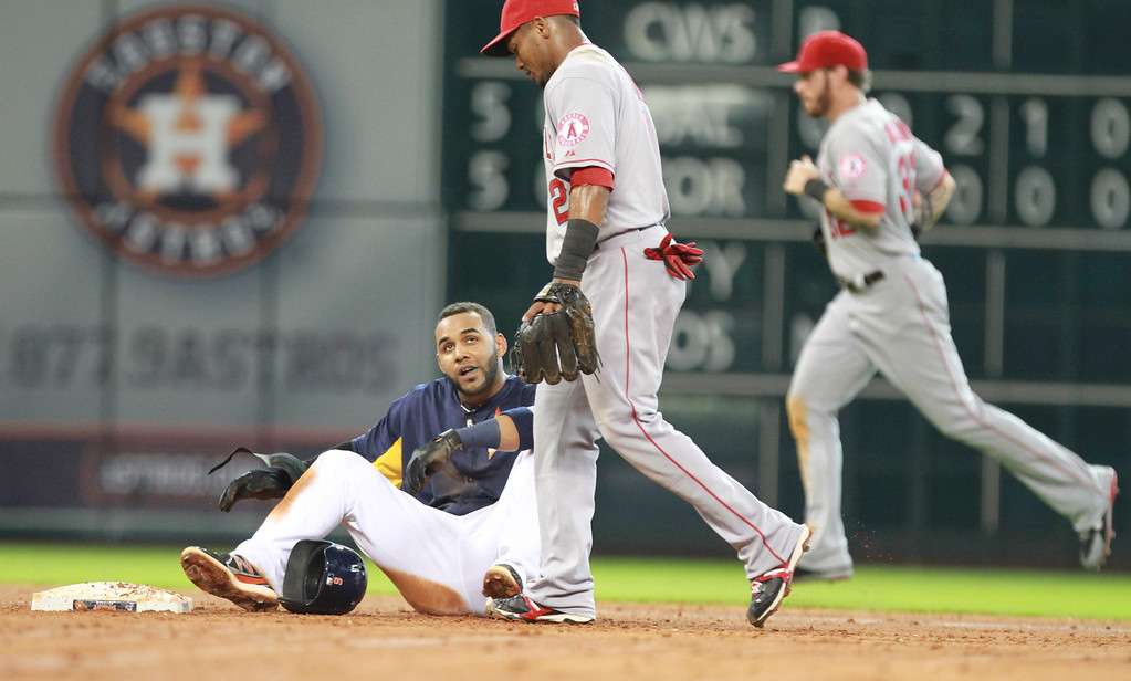 . HOUSTON, TX- SEPTEMBER 15: Jonathan Villar #6 of the Houston Astros sits dejected a second base after the Los Angeles Angels of Anaheim turned a double play in the fifth inning on September 15, 2013 at Minute Maid Park in Houston, Texas. (Photo by Thomas B. Shea/Getty Images)