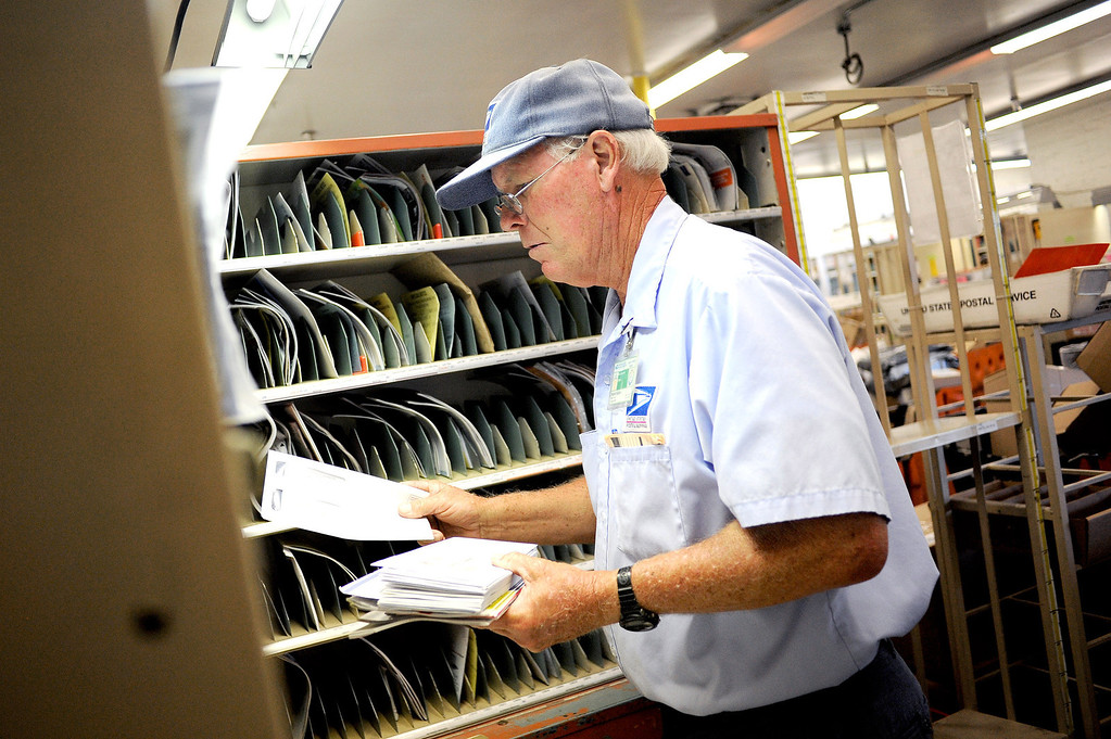 . Letter carrier Robert Golden sorts mail at the Mission Hills USPS Annex Friday, June 28, 2013.  Monday will mark the 50th anniversary of the so-called Zoning Improvement Plan (ZIP).(Andy Holzman/Los Angeles Daily News)