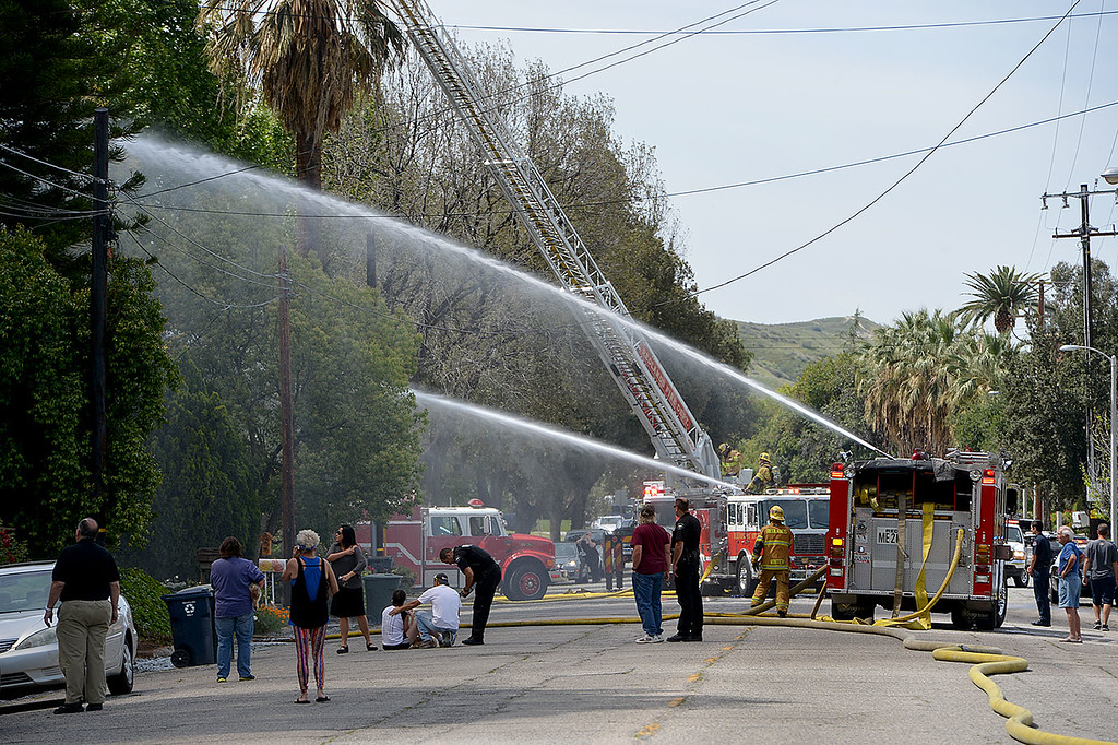 . A Redlands\' home in the 1600 block of Olive Street, one of the city�s historic neighborhoods, was destroyed in a fire Wednesday April 9, 2014, according to fire officials. When they arrived they found the home, built in 1903, engulfed in flames and smoke billowing out of the structure. (Photo by Rick Sforza/The Sun)