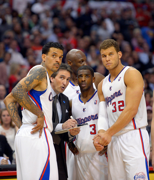 . Los Angeles Clippers head coach Vinny Del Negro, second from left, talks with forward Matt Barnes, left, forward Lamar Odom, third from left, guard Chris Paul, second from right, and forward Blake Griffin during the second half of their NBA basketball game against the Indiana Pacers, Monday, April 1, 2013, in Los Angeles. (AP Photo/Mark J. Terrill)