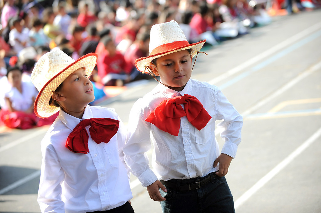. Students wear folklorico attire during the Canoga Park Elementary School Centennial Celebration May 17, 2013.  Live musicians, performances by students, an LAPD helicopter flyover and speakers were featured during the event in Canoga Park, CA Friday.(Andy Holzman/Staff Photographer)