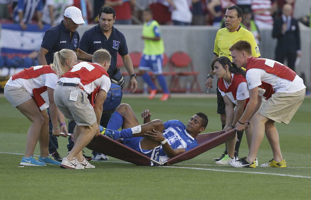 . The stretcher breaks as Honduras\' Carlo Costly is taken off the field injured in the first half during an World Cup qualifying soccer match against the U.S. at Rio Tinto Stadium on Tuesday, June 18, 2013, in Sandy, Utah.  (AP Photo/Rick Bowmer)