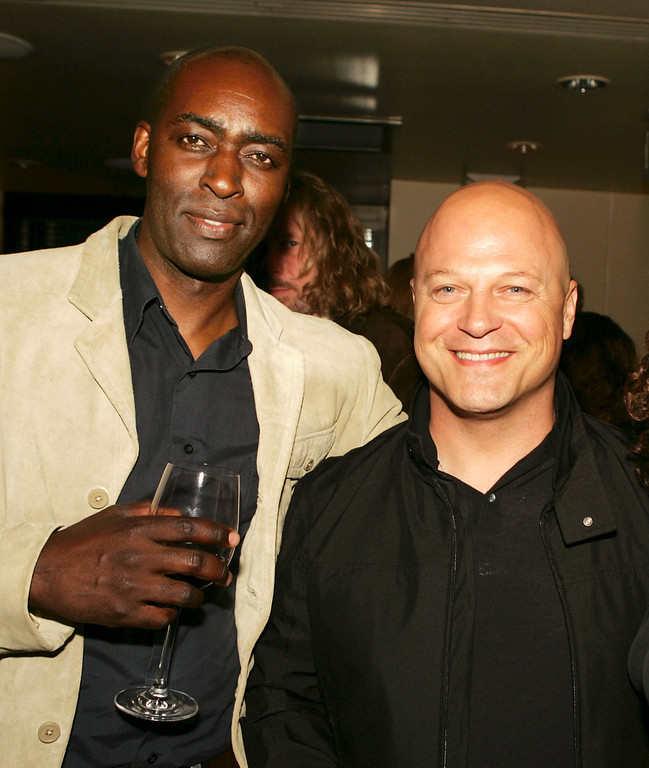 """. Actors Michael Jace (L) and Michael Chiklis pose at the afterparty for the 4th season screening premiere of FX\'s \""""The Shield\"""" at Meson G Resturaunt on March 12, 2005 in Los Angeles, California. (Photo by Kevin Winter/Getty Images)"""