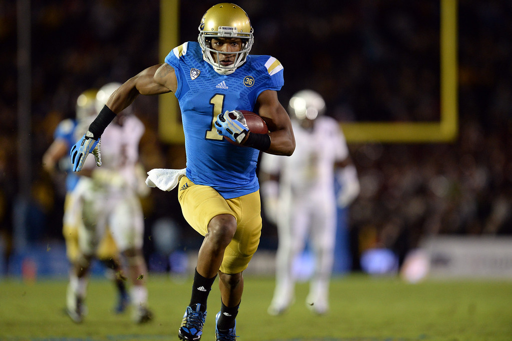 . UCLA�s Shaquelle Evans #1 heads for the end zone on a 27-yard touchdown catch during their game against Arizona State at the Rose Bowl Saturday November 23, 2013. Arizona State beat UCLA 38-33. (Photos by Hans Gutknecht/Los Angeles Daily News)
