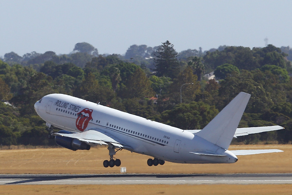 . PERTH, AUSTRALIA - MARCH 20:  The Rolling Stones depart Perth international airport on March 20, 2014 in Perth, Australia. The Rolling Stones today cancelled their Australian and New Zealand tour following news Mick Jagger\'s girlfriend, fashion designer L\'Wren Scott, committed suicide in New York.  (Photo by Paul Kane/Getty Images)