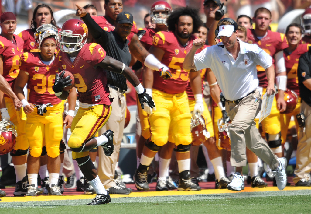 . USC #9 Marqise Lee runs 80 yards for a TD after receiving a pass from QB Cody Kessler, while Coach Lane Kiffin chases him down the sideline in the 2nd quarter. USC Plays Boston College at the Coliseum in Los Angeles, CA. 9/14/2013. photo by (John McCoy/Los Angeles Daily News)