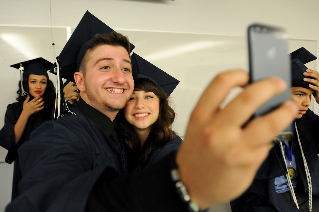 . Students at Northridge Academy High School before the graduation ceremony on Thursday, June 5, 2014. (Photo by Dean Musgrove/Los Angeles Daily News)