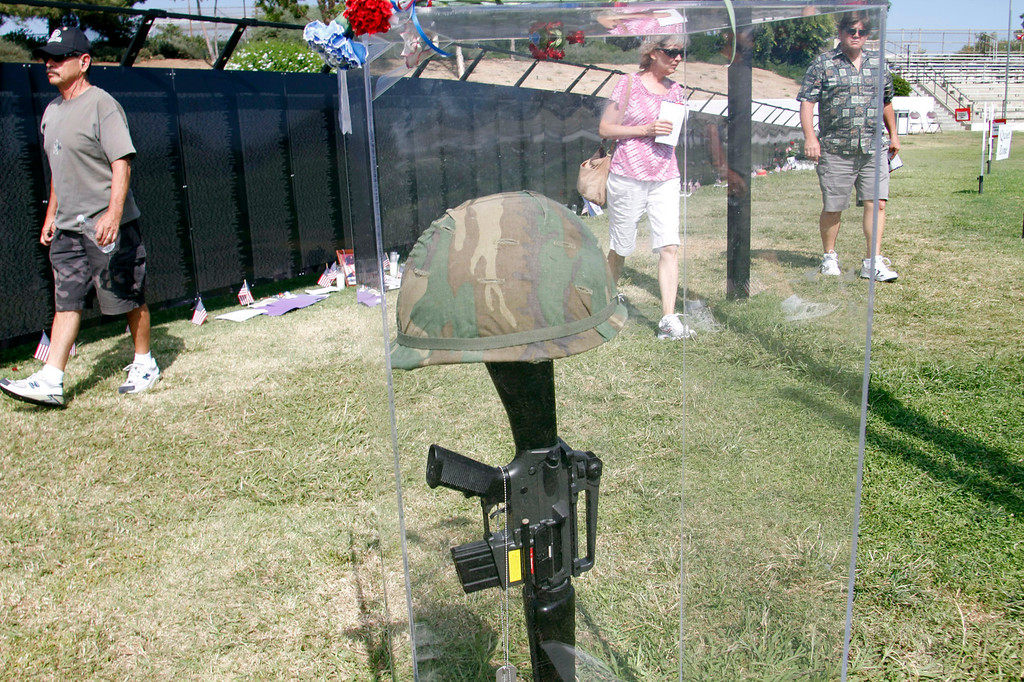 """. Guests get a last chance to view the Vietnam Veterans Memorial, during the Vietnam Veterans Memorial \""""The Wall That Heals\"""" Closing Ceremony event, at La Habra High School, in La Habra, Sunday, July 14, 2013. (SGVN/Correspondent Photo by James Carbone)"""