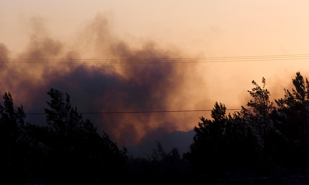 . Residents watch the Etiwanda Fire from Wilson Avenue as the sun sets in Rancho Cucamonga, CA, Wednesday, April 30, 2014. (Photo by Jennifer Cappuccio Maher/Inland Valley Daily Bulletin)