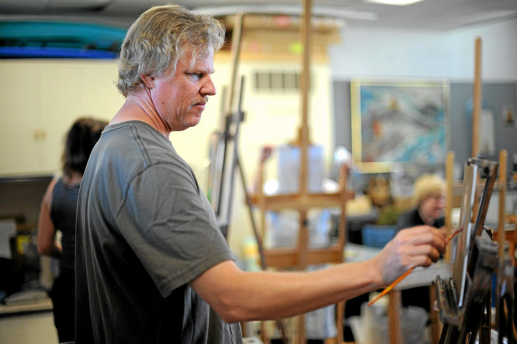 . Artist David C. Gallup has created a large body of paintings of the Channel Islands National Park and Marine Sanctuary.  Here he is in his Camarillo studio October 1, 2013.(Andy Holzman/Los Angeles Daily News)