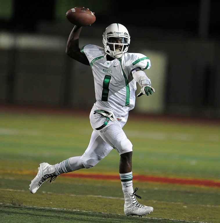 . Monrovia quarterback Deshawn Potts (1) passes against Arcadia in the first half of a prep football game at Arcadia High School in Arcadia, Calif. on Friday, Sept. 13, 2013.   (Photo by Keith Birmingham/Pasadena Star-News)