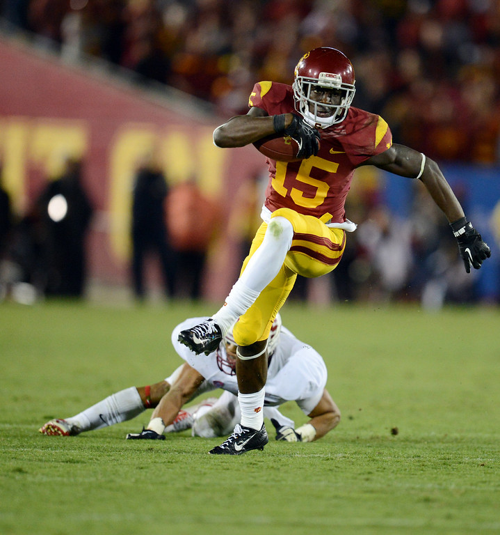 . USC�s Nelson Agholor #15 picks up a first down late in the 4th quarter during their game against Stanford at the Los Angeles Memorial Coliseum Saturday, November 16, 2013. USC beat Stanford 20-17. (Photos by Hans Gutknecht/Los Angeles Daily News)