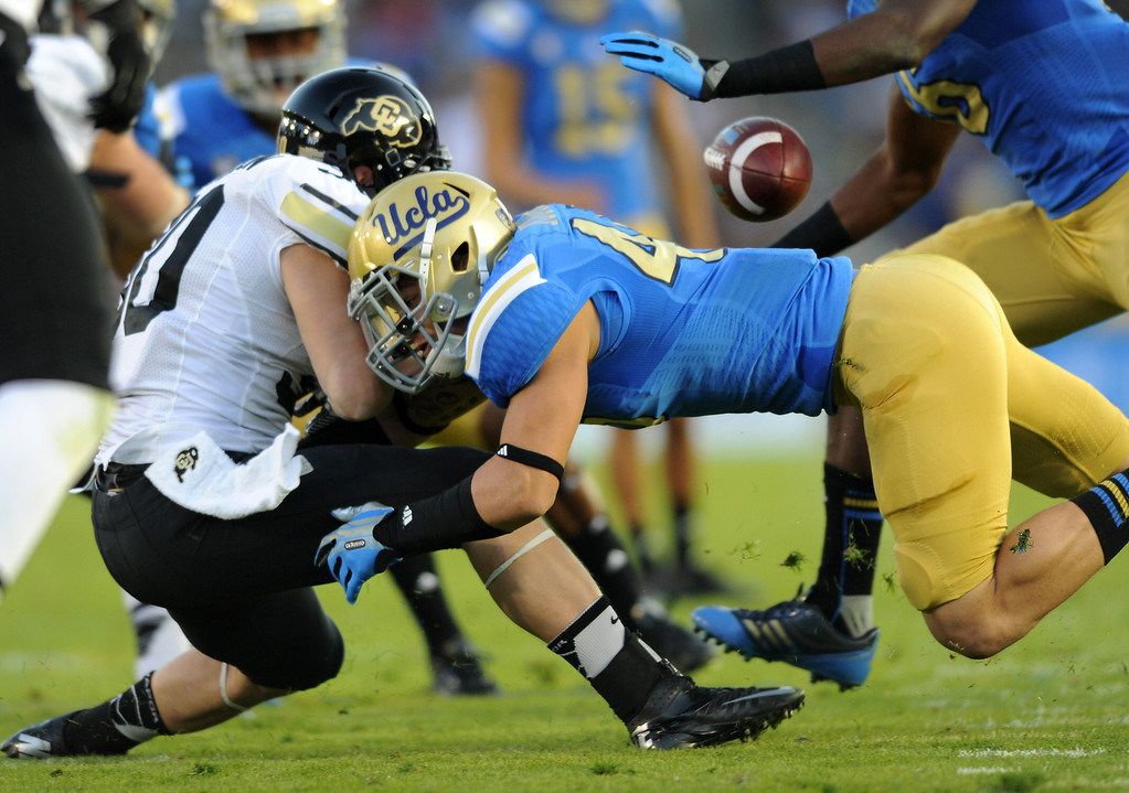 . UCLA\'s Cameron Judge hits Colorado\'s Ryan Severson during a kick return causing a fumble which UCLA recovered, Saturday, November 2, 2013, at the Rose Bowl. (Photo by Michael Owen Baker/L.A. Daily News)