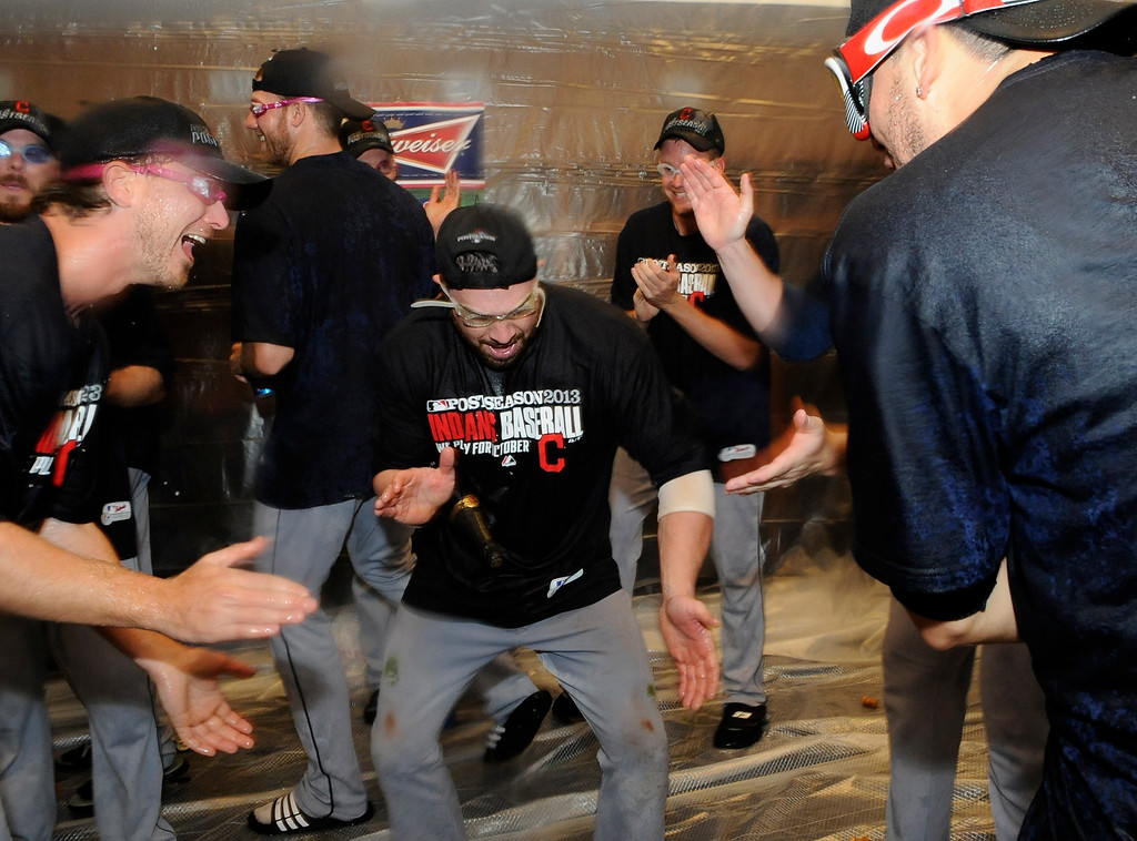 . MINNEAPOLIS, MN - SEPTEMBER 29: Josh Tomlin #43 and Jason Kipnis #22 of the Cleveland Indians celebrate with champagne in the clubhouse after a win of the game against the Minnesota Twins on September 29, 2013 at Target Field in Minneapolis, Minnesota. The Indians defeated the Twins 5-1 and clinched a American League Wild Card berth. (Photo by Hannah Foslien/Getty Images)