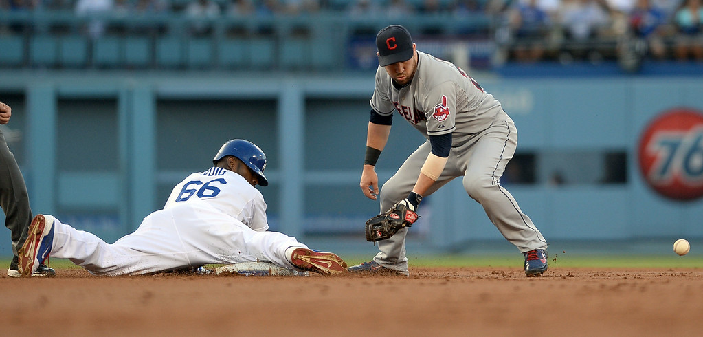 . Los Angeles Dodgers Yasiel Puig is safe at second with a double against the Cleveland Indians July 1, 2014 in Los Angeles.(Andy Holzman/Los Angeles Daily News)