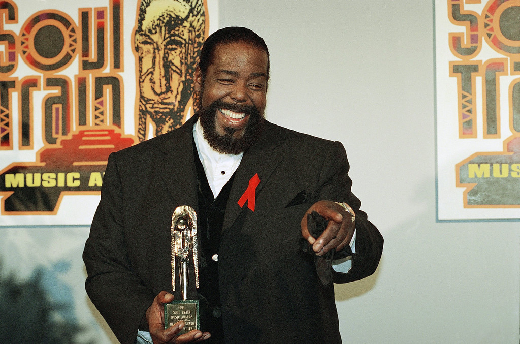 . Singer Barry White shown with his trophy after being honored with the Heritage Award for career achievement at the eighth annual Soul Train Music Awards at the Shrine Auditorium in Los Angeles on Tuesday, March 15, 1994. (AP Photo/Rhonda Birndorf)