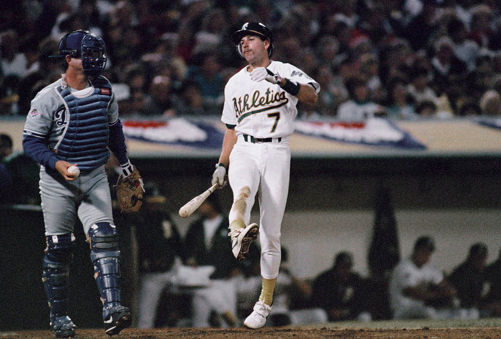. Oakland As Walt Weiss (7) reacts after striking out to end the eighth inning leaving a runner on first base in the fourth game of the World Series against the Los Angeles Dodgers at Oakland Coliseum, Wednesday, Oct. 19, 1988, Oakland, Calif. The Dodgers held on for a 4-3 win and now lead the best of seven series 3-1. The catcher is unidentified. (AP Photo/Eric Risberg)