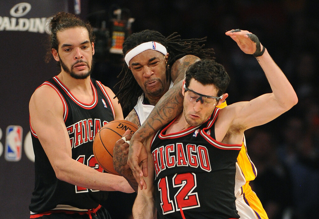 . The Los Angeles Lakers\' Jordan Hill tangles up with Chicago Bulls\' Joakim Noah, left, and Kirk Hinrich in the NBA basketball game at Staples Center in Los Angeles, CA. on Sunday, February 9, 2014. (Photo by Sean Hiller/ Daily Breeze).